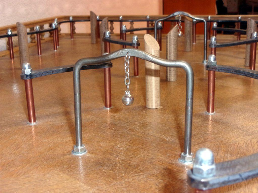 arceau et clochette de la table à toupie